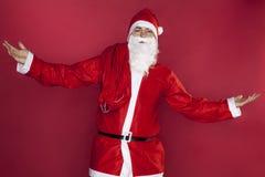 Santa Claus répand ses mains dans l'abandon Photographie stock