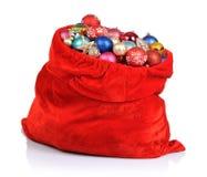 Santa Claus röd påse med jultoys Royaltyfria Foton