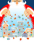 Santa Claus rain gifts in city. Christmas in town. Royalty Free Stock Photo