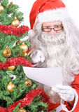 Santa Claus read letter Stock Photography
