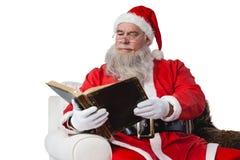 Santa claus reading bible Stock Photos