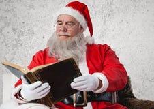 Santa claus reading bible Stock Photography