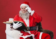 Santa claus reading bible Royalty Free Stock Image