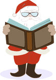 Santa Claus reading a big book Royalty Free Stock Image