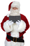 Santa Claus reading a book Royalty Free Stock Photos
