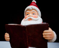 Santa Claus reading a book Stock Image