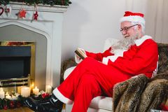Santa Claus reading book Stock Images