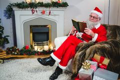 Santa Claus reading book Stock Photo