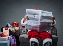 Santa Claus reading business news Stock Images