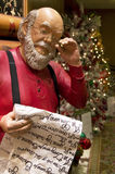 Santa Claus reading the gift list Stock Images