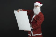Santa Claus reading gift list Stock Image