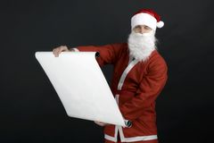 Santa Claus reading gift list Stock Photos