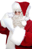 Santa Claus reading a letter Royalty Free Stock Image