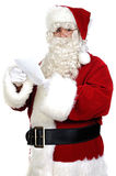 Santa Claus reading a letter. Over white background Stock Image