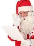 Santa Claus Reading Letter. Santa reading a letter with a shocked expression Stock Photos