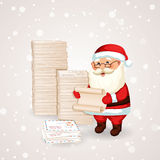 Santa Claus reading a letter. Royalty Free Stock Photos