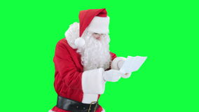 Santa Claus reading a letter chroma key (green screen) stock video footage