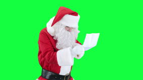 Santa Claus reading a letter chroma key (green screen) stock video