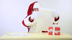 Santa Claus reading a letter stock video footage