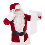 Santa Claus reading a letter Stock Photography