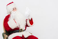 Santa Claus Reading Letter isolated over white baclground Royalty Free Stock Photos