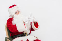 Santa Claus Reading Letter isolated over white baclground Stock Photography