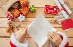 Santa Claus reading letters Royalty Free Stock Photos