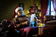 Santa Claus reading letters Stock Photo