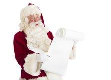 Santa Claus Reading List Royaltyfri Bild