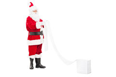 Santa Claus reading a list of wishes. Isolated on white background Stock Image
