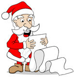 Santa Claus reading a long wish list Royalty Free Stock Images