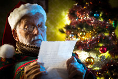 Santa Claus reading mail Royalty Free Stock Images