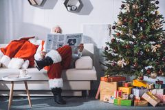 Santa claus reading newspaper Royalty Free Stock Image