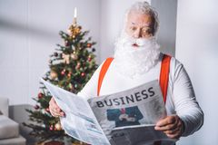 Santa claus reading newspaper Stock Image