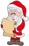 Santa Claus reading parchment Stock Images