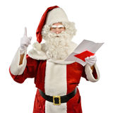Santa Claus Reading a Strange Wish List Royalty Free Stock Images