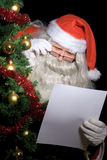 Santa Claus reading wish list Stock Photo