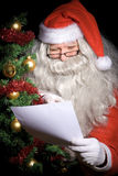 Santa Claus reading wish list Stock Image