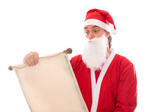 Santa Claus reading in a wish list scroll, isolated on white, co Royalty Free Stock Photos