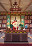 Santa Claus Reading Wish List Sitting At Desk In Christmas And New Year Holidays Office Royalty Free Stock Photography