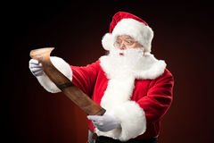 Santa Claus reading wishlist Royalty Free Stock Image