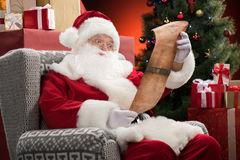 Santa Claus reading wishlist Stock Images