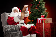 Santa Claus reading wishlist Stock Image