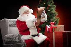 Santa Claus reading wishlist Royalty Free Stock Photo