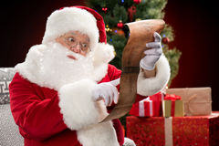 Santa Claus reading wishlist Stock Photography
