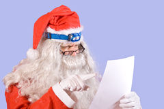 Santa Claus reads the letter Stock Photo