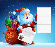 Santa Claus reads a letter of congratulation. In his hands he holds a festive envelope. Next to Santa Claus bag with gifts, sweets and surprises. Happy New Royalty Free Stock Photo