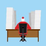 Santa Claus reads letter. Many  incoming correspondence from chi Stock Photo