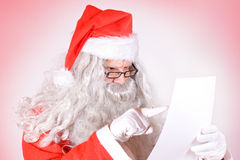 Santa Claus reads the list Royalty Free Stock Photo