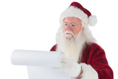 Santa Claus reads a list Stock Images